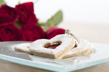 Gold engagement ring and shortbread hearts