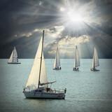 The sailboats on a sea against dramatic sky.