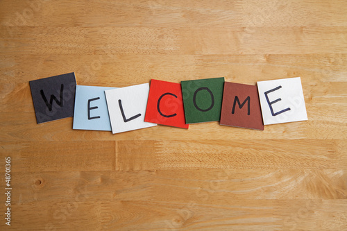 'Welcome' words on color tiles - education, business, medical.