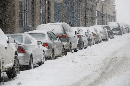 Parked cars on snowy street