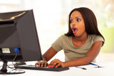 african young woman using instant message look surprised