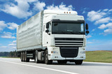 Fototapety White lorry with grey trailer over blue sky
