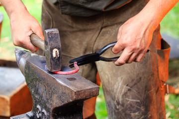 Forging a horse shoe