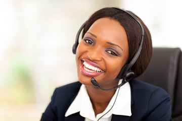 happy african american call center operator with headphones