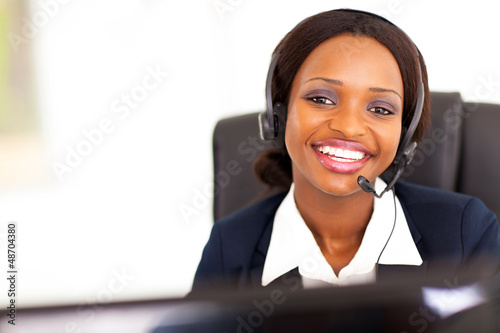 happy african american telephonist in front of computer