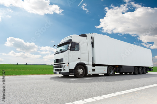 canvas print picture white lorry with trailer over blue sky