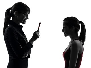 teacher woman mother teenager girl discussion  in silhouette