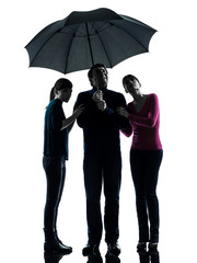 family father mother daughter under umbrella  danger afraid  si