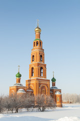 Orthodox bell tower of red brick