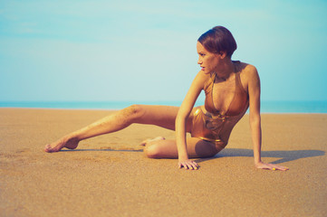 Sensual woman laying on beach