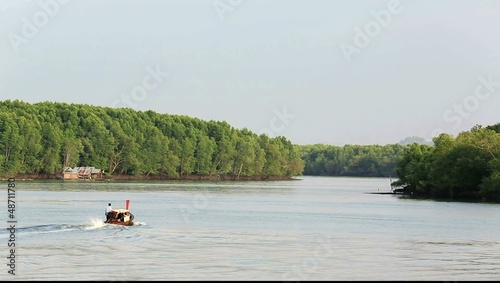 Long tail boat heading out to mangrove forest in Krabi, Thailand