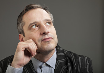 portrait of adult man isolated on dark background