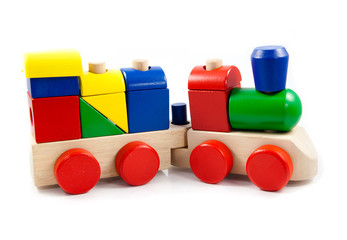Colorful wooden toy train isolated on white background