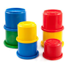 Colorful toys for kids. plastic cups on the white background