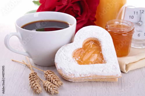 coffee and heart shape biscuit