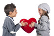 Couple of kids playing with red heart over white background.
