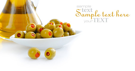 Green olives stuffed with pimento on a white background