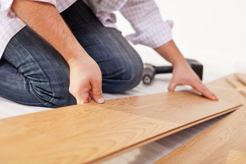 Laying laminate flooring - closeup