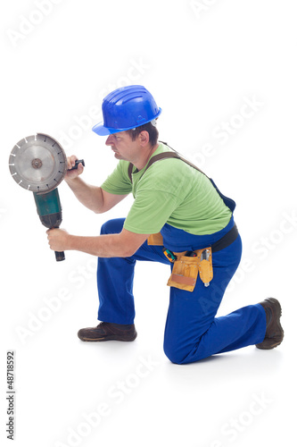 Worker using power tool