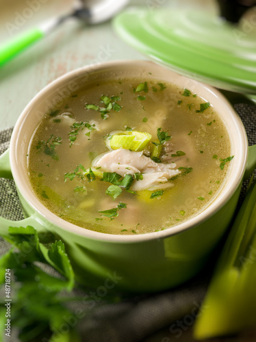 soup with chicken and leek, selective focus