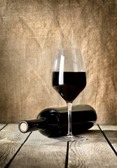 Black bottle of wine and wneglass