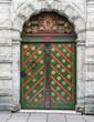Green antique door texture with plaster wall around