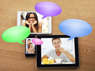 digital tablets with images and bubbles chat icon
