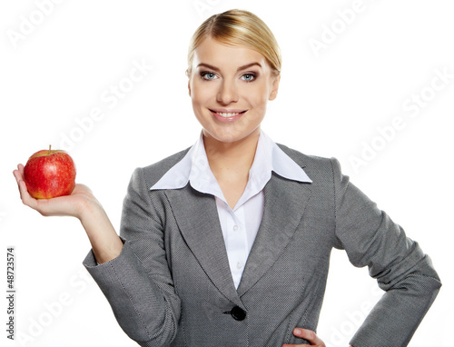 Businesswoman with red apple in her hand - healthy eating concep