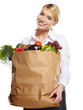 Portrait of happy business woman holding a shopping bag full of