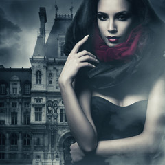 sexy woman in black hood and castle