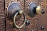 Medieval metal handle and doorknob on a wooden door