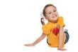 Cheerful little girl in a yellow shirt