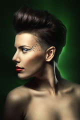 woman with red lips in dark green light