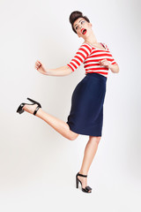 cute jumping woman in t-shirt and skirt