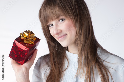 blonde woman holding giftbox