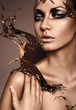 canvas print picture - close up portrait of attractive woman with chocolate splash