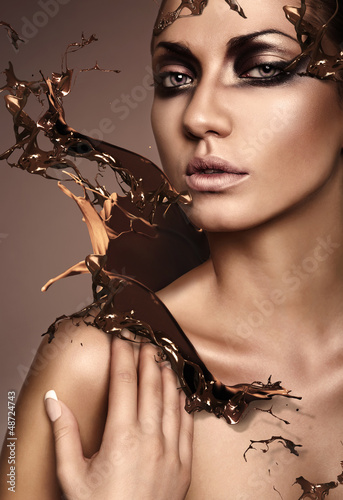 close up portrait of attractive woman with chocolate splash