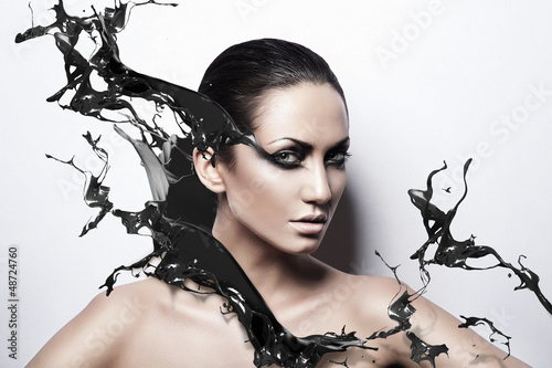 close up portrait of passion brunette woman with black splash