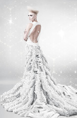 woman in long white dress with creative hairstyle