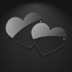 Vector two glass hearts over metal background