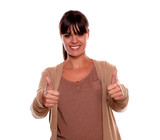 Smiling young woman with fringes making ok sign poster