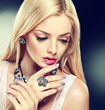 Beautiful fashion model in jewelery and lilaс  manicure