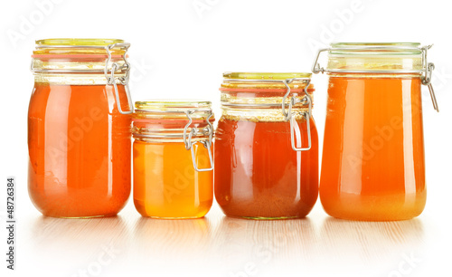 Composition with jar of honey isolated on white