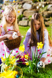 Fototapety Children on Easter egg hunt with bunny