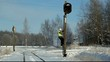 Railroad worker  climbing on  signal beacons pole