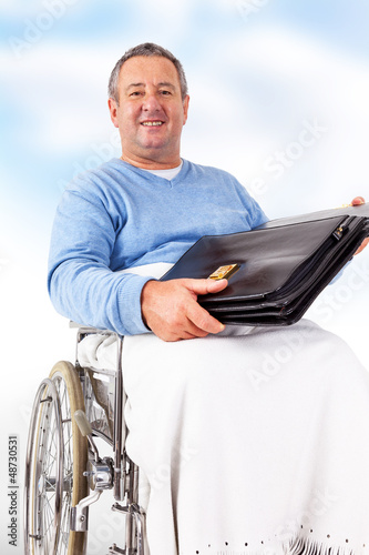 Man in wheelchair with a briefcase