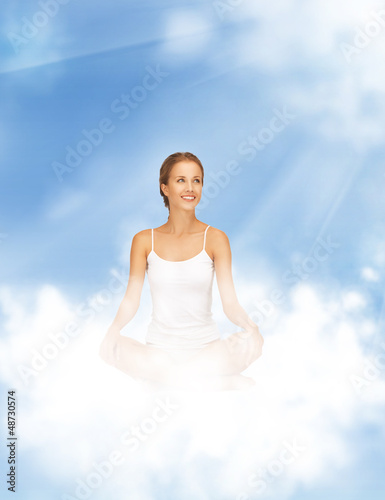woman practicing yoga lotus pose
