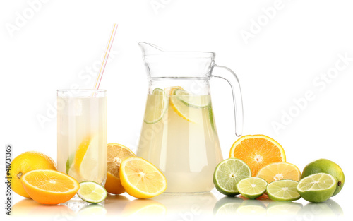 Citrus lemonade in pitcher and glass of citrus around isolated
