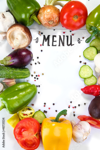 Menu surrounded by products and vegetables isolated on white
