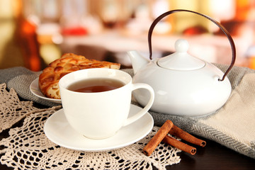 cup of tea with scarf on table in room